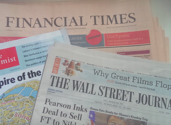 Pile of newspapers including the Financial Times and The Wall Street Journal