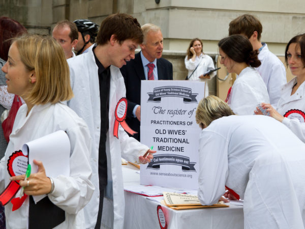 Photograph of young scientists in white lab coats
