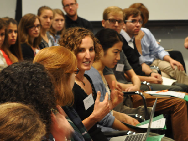 Woman speaking in row of early career researchers