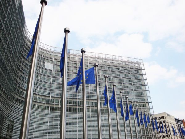 Berlaymont building with row of EU flags in the foreground
