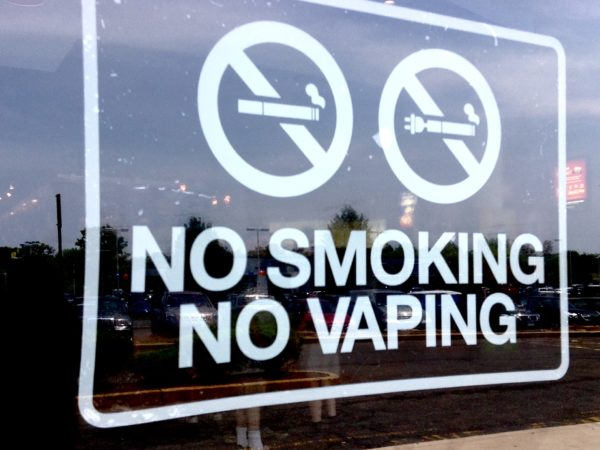 No smoking No vaping sign on glass.