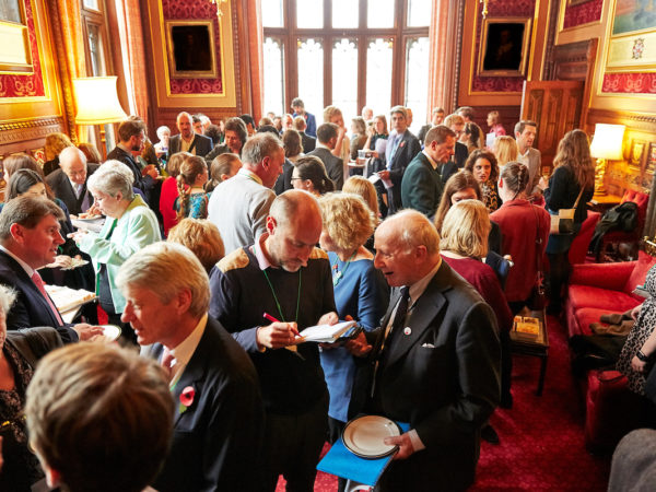 Crowds talking at evidence matters event in parliament