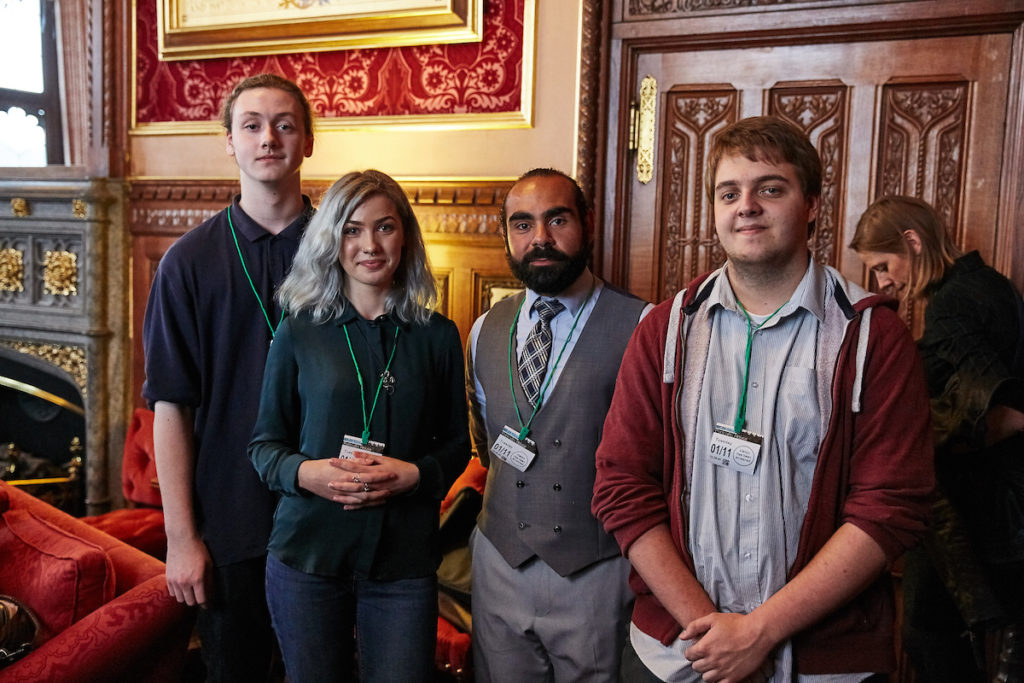 Teacher Ahmed with his students at evidence matters event in parliament