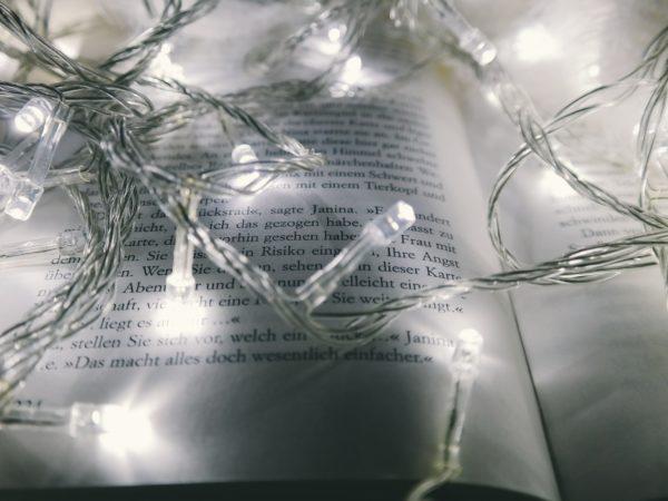 White fairy lights on open book